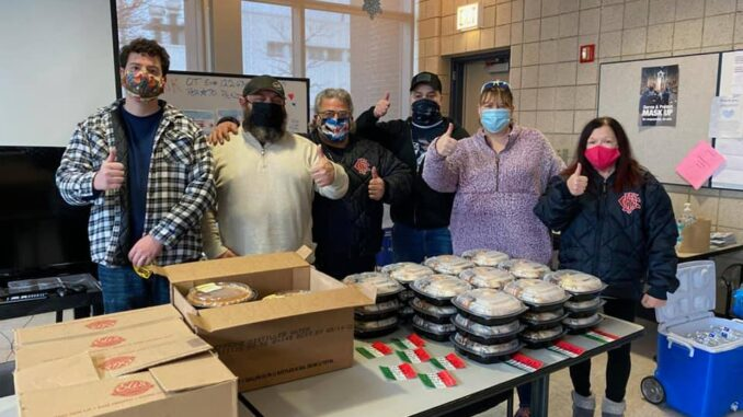 Neighbors Bring Thanksgiving Dinners to 16th District Police Dept